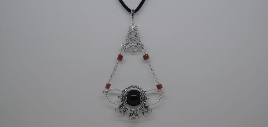 THE HISTORY OF SU COCCU, THE AMULET
